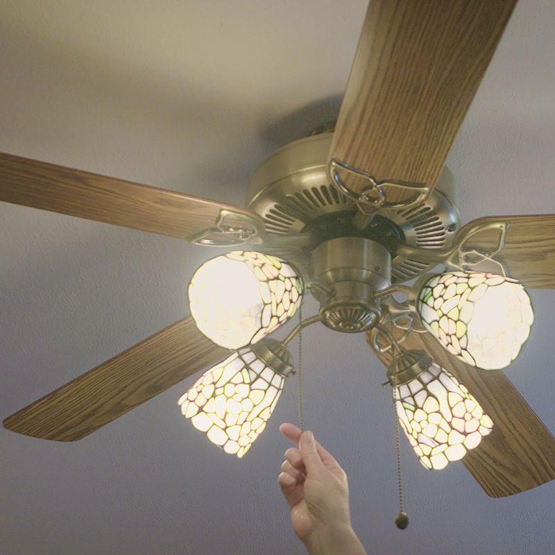 Man Turning on Ceiling Fan